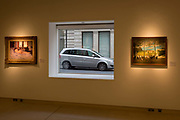 A parked car is framed inside the window of art auctioneers Christies, on 19th November 2017, in London, England.