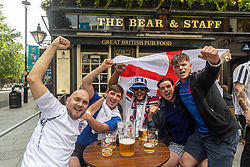 Licensed to London News Pictures. 07/07/2021. London, UK. England fans cheer and enjoy a drink at a pub in Leicester Square, London ahead of the Euro 2020 semi-final between England and Denmark at Wembley tonight for a place in the finals this Sunday (11 July 2021). Today, England taken on Denmark in the first semi-final since 1996 as eager fans start to gather in London. Photo credit: Alex Lentati/LNP