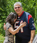 Houston ISD Board president Juliet Stipeche, left, and trustee Manuel Rodriguez, Jr, after taking the ALS Ice Bucket Challenge, August 21, 2014.