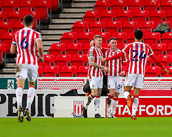 Jordan Thompson of Stoke City is congratulated by James McClean of Stoke City and Jordan Cousins of Stoke City after scoring a goal - Mandatory by-line: Nick Browning/JMP - 23/12/2020 - FOOTBALL - Bet365 Stadium - Stoke-on-Trent, England - Stoke City v Tottenham Hotspur - Carabao Cup