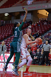 10 December 2017: Megan Talbot shoots from under Tori Easley during an College Women's Basketball game between Illinois State University Redbirds and the Eagles of Eastern Michigan at Redbird Arena in Normal Illinois.