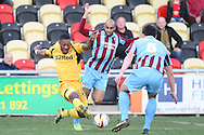 Ryan Jackson of Newport County battles past Marcus Williams and Niall Canavan of Scunthorpe. Skybet football league 2 match, Newport county v Scunthorpe Utd at Rodney Parade in Newport, South Wales on Saturday 1st March 2014.<br /> pic by Mark Hawkins, Andrew Orchard sports photography.
