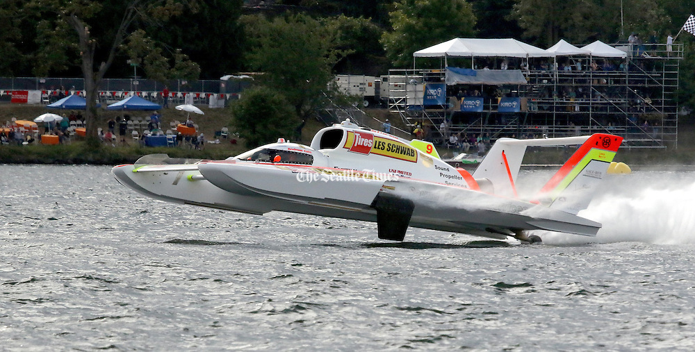 Rookie driver Andrew Tate in the Les Schwab/Sound Propeller takes off and goes high in the air on the final lap, winning the race. (Greg Gilbert/The Seattle Times, 2016)