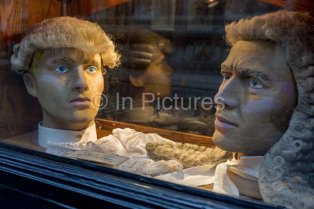 Court dress wigs for the legal profession barristers and judges donated by outfitters Ede & Ravenscroft, in the window of the Seven Stars pub opposite the Royal Courts of Justice, on 15th February 2017, in London, United Kingdom.