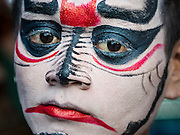 "14 MAY 2015 - BANGKOK, THAILAND:    A Chinese opera performer backstage before a show at the Pek Leng Keng Mangkorn Khiew Shrine in the Khlong Toey slum in Bangkok. Chinese opera was once very popular in Thailand, where it is called ""Ngiew."" It is usually performed in the Teochew language. Millions of Chinese emigrated to Thailand (then Siam) in the 18th and 19th centuries and brought their culture with them. Recently the popularity of ngiew has faded as people turn to performances of opera on DVD or movies. There are still as many 30 Chinese opera troupes left in Bangkok and its environs. They are especially busy during Chinese New Year and Chinese holiday when they travel from Chinese temple to Chinese temple performing on stages they put up in streets near the temple, sometimes sleeping on hammocks they sling under their stage. Most of the Chinese operas from Bangkok travel to Malaysia for Ghost Month, leaving just a few to perform in Bangkok.    PHOTO BY JACK KURTZ"