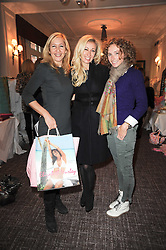Left to right, TANIA BRYER, JENNY HALPERN and JO MANOUKIAN at a shopping afternoon hosted by Amanda Kyme and Tamara Beckwith featuring designs from Elizabeth Hurley held at the Cadogan Hotel, 75 Sloane Street, London SW1 on 23rd November 2010.