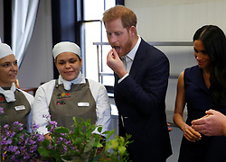 The Duke of Sussex tastes traditional native Australian ingredients during a visit with his wide, the Duchess of Sussex, to Mission Australia social enterprise restaurant Charcoal Lane in Melbourne, on the third day of the royal couple's visit to Australia.