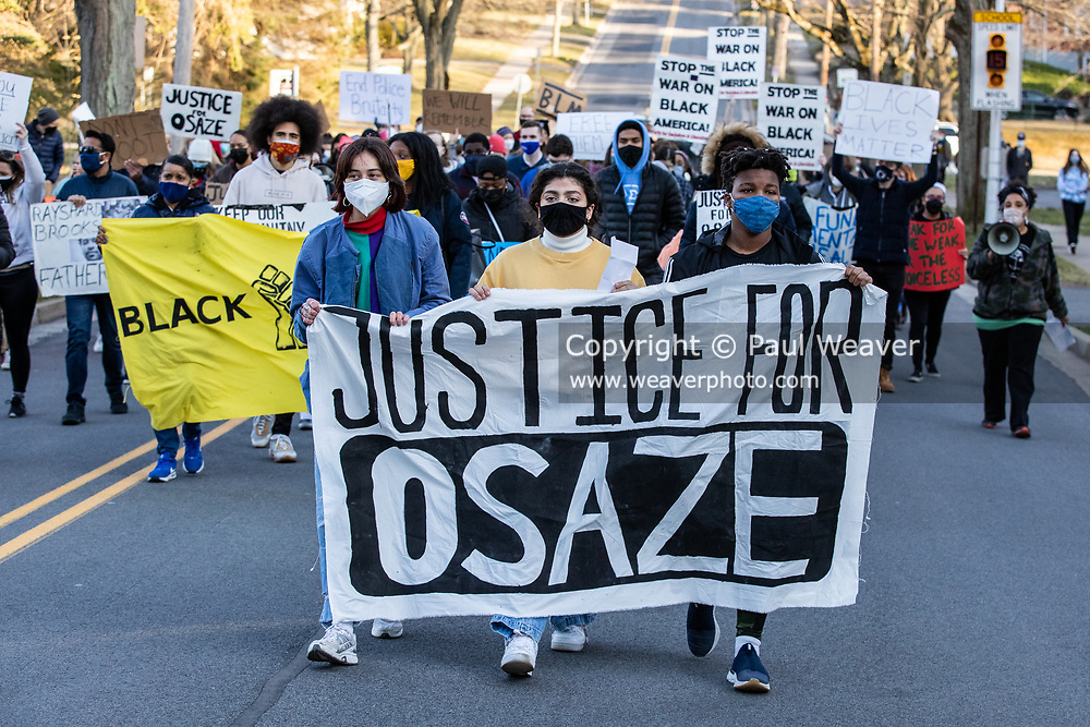 Protesters are seen marching in the streets of oState College demanding justice for Osaze Osagie who was killed by police in 2019.