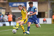 Oxford United midfielder Gavin Whyte (16) hold up the ball under pressure from Wycombe Wanderers defender Joe Jacobson (3) during the EFL Sky Bet League 1 match between Wycombe Wanderers and Oxford United at Adams Park, High Wycombe, England on 15 September 2018.