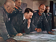 Adolph Hitler (1889-1945) German Fascist dictator and Benito Mussolini (1883-1945) Italian Fascist dictator being shown the map of the military positions in Europe.