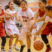 Gallup Bengals Summer Chee (34) and Kamryn Yazzie (20) grab the ball away from Espanola Sundevil Jaylynn Padilla (30) Tuesday at Gallup High School.