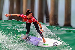 HUNTINGTON BEACH, CA - Malia Manuel surfs at the quarter finals during the 2014 Vans US Open of Surfing.  2014 Aug 2. Byline, credit, TV usage, web usage or linkback must read SILVEXPHOTO.COM. Failure to byline correctly will incur double the agreed fee. Tel: +1 714 504 6870.
