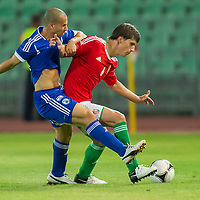 Israel's Gil Naftali Vermouth (L) and Hungary's Zsolt Laczko (R) fight for the ball during a friendly football match Hungary playing against Israel in Budapest, Hungary on August 15, 2012. ATTILA VOLGYI