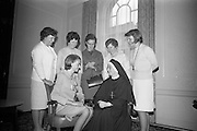 20/08/1966<br /> 08/20/1966<br /> 20 August 1966<br /> Irish Zambian Missionaries reunion at Wynn's Hotel Dublin. Group of Irish teachers, nurses, priests and sisters all of whom were connected with the Capuchin and Holy Cross Mission in Zambia and Rhodesia met at an informal luncheon. Picture shows: Sr. M. Lelia, (seated right) of Holy Cross Convent, Glen Road, Belfast, who organised the gathering after returning to Ireland after 34 years in Africa, chatting with Miss Margaret McDonald (seated left), Portadown and (l-r) Miss Moira Corrigan, Enniskillen; Miss Anne Kelly, Frosses, Co. Donegal; Miss Mary O'Kane, Belfast; Miss Bernadette O'Callaghan, Newry and Miss Kathleen Brothers, Derry.
