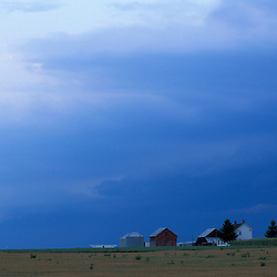 Queen Anne's County, MD. A storm front moves in over farm buildings at Chino Farms. Eastern Shore.