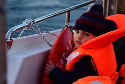 ANTALYA, TURKEY - MARCH 12: A refugee kid is seen in a rescue boat after total of 174 Syrian refugees captured by Turkish coast guard while they were illegally trying to reach Greece's, in shores of Antalya, southern province of Turkey on March 12, 2016. Suleyman Elcin / Anadolu Agency  | BRAA20160312_103 Antalya Turquie Turkey