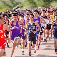 The boys varsity bunch up from the start line during the Rehoboth Invitational cross country meet in Rehoboth Friday.