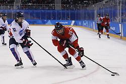 February 18, 2018 - Pyeongchang, KOREA - Switzerland forward Dominique Ruegg (26) and Korea forward Heewon Kim (12) in a hockey game between Switzerland and Korea during the Pyeongchang 2018 Olympic Winter Games at Kwandong Hockey Centre. Switzerland beat Korea 2-0. (Credit Image: © David McIntyre via ZUMA Wire)