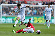 Jack Cork of Swansea city jumps over the tackle from Alvaro Negredo of Middlesbrough . Premier league match, Swansea city v Middlesbrough at the Liberty Stadium in Swansea, South Wales on Sunday 2nd April 2017.<br /> pic by Andrew Orchard,