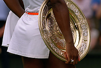 Serena Williams holds the Womens Champions Plate. Wimbledon Tennis Championship, Day 12, 5/07/2003. Credit: Colorsport / Matthew Impey