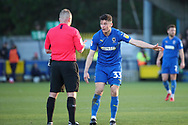 AFC Wimbledon midfielder Callum Reilly (33) talking to the ref and pointing during the EFL Sky Bet League 1 match between AFC Wimbledon and Fleetwood Town at the Cherry Red Records Stadium, Kingston, England on 8 February 2020.