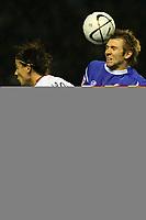 Photo: Pete Lorence.<br />Leicester City v Aston Villa. Carling Cup. 24/10/2006.<br />Leicester's Gareth McAuley reaches over Villa's Milan Baros.