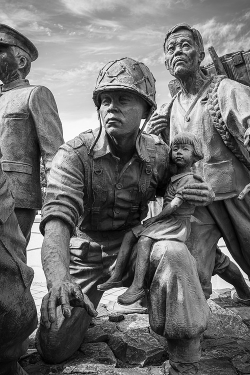 """Seoul, South Korea - September 26, 2019: Detail from the Defending the Fatherland sculpture outside the War Memorial of Korea in Seoul. """"The statues represent 38 people from all walks of life who overcame the Korean War and depict the suffering and pain caused by the war while embodying the sublime spirit of sacrifice and dedication to the defense of the fatherland of past patriots."""""""