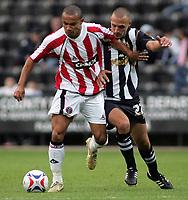 Photo: Paul Thomas.<br /> Notts County v Sheffield United. Pre Season Friendly. 01/08/2006.<br /> <br /> Danny Webber of Sheffield (L) tries to get past Dan Gleeson.