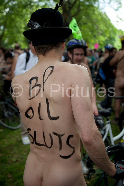 People with aniti BP slogans against oil and vehicle emissions at the World Naked Bike Ride taking place in London. A peaceful, imaginative and fun protest against oil dependency and car culture. A celebration of the bicycle and also a celebration of the power and individuality of the human body. A symbol of the vulnerability of the cyclist in traffic. The world's biggest naked protest: 50+ cities and thousands of riders participate worldwide, including around 1500 in London.