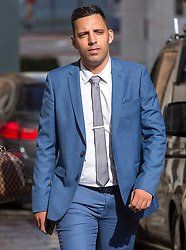 © Licensed to London News Pictures. 08/08/2018. Bristol, UK. RYAN ALI arrives at Bristol Crown court today for the third day of his trial on charges of affray that relate to a fight outside a Bristol nightclub on September 25 2017. England cricketer Ben Stokes and two other men, Ryan Ali, 28, and Ryan Hale, 27, all deny the charge. Stokes, Ali and Hale are jointly charged with affray in the Clifton Triangle area of Bristol on September 25 last year, several hours after England had played a one-day international against the West Indies in the city. A 27-year-old man allegedly suffered a fractured eye socket in the incident. Photo credit: Simon Chapman/LNP