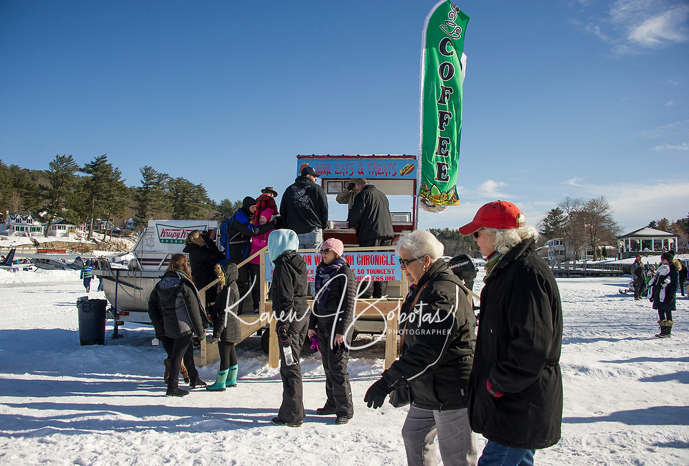 MML Eats and Treats greeted folks as they walked onto the ice at Alton Bay during Winter Carnival on Sunday.  (Karen Bobotas/for the Laconia Daily Sun)