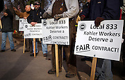 KOHLER, WI — DECEMBER 9, 2015: UAW Local 833 employees strike outside the Kohler manufacturing facility, Tuesday, December 8, 2015. Around 2,100 Kohler employees and union members are currently maintaining a 24/7 picket line outside the plant.