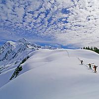 Off-piste skiers hike below Mount Shuksan, near Mount Baker Ski Area,