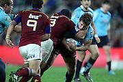 Luke Burgess taken by Bronson Murray. NSW Waratahs v Otago Highlanders. Investec Super Rugby Round 17 Match, 11 June 2011. Sydney Football Stadium, Australia. Photo: Clay Cross / photosport.co.nz