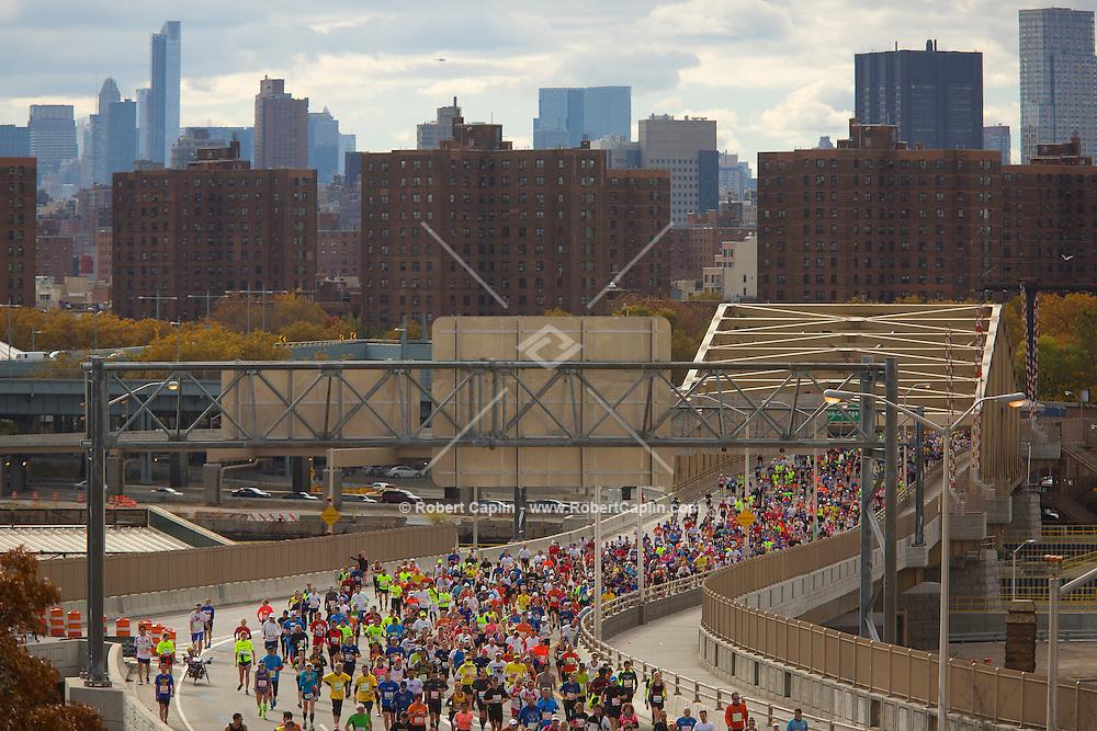 NEW YORK, NY – NOVEMBER 3, 2013: Marathon runners enter The Bronx via the Willis Avenue Bridge during the 2013 New York City Marathon.  <br /> <br /> Photo by Robert Caplin