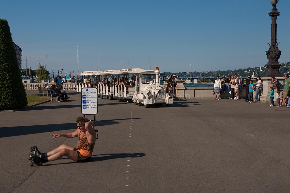 Rollerblader in leopardskin picks up himself up as tourist train arrives in Geneva.