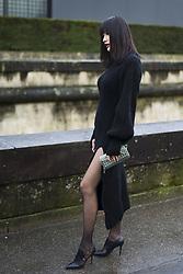 March 4, 2018 - Paris, France - A guest wears a black wool dress and a green bag, outside Valentino, during Paris Fashion Week Womenswear Fall/Winter 2018/2019, on March 4, 2018 in Paris, France. (Credit Image: © Nataliya Petrova/NurPhoto via ZUMA Press)
