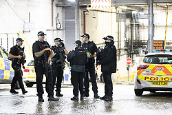 © Licensed to London News Pictures. 18/10/2019. Manchester, UK. Armed police and paramedics respond and the Arndale Centre and surrounding streets in Manchester City Centre are evacuated after reports of a man armed with a knife in the shopping centre . Photo credit: Joel Goodman/LNP
