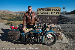 American Iron Magazine publisher Buzz Kanter with his 1936 Harley-Davidson VLH at the top of Loveland Pass during Stage 10 (278 miles) of the Motorcycle Cannonball Cross-Country Endurance Run, which on this day ran from Golden to Grand Junction, CO., USA. Monday, September 15, 2014.  Photography ©2014 Michael Lichter.
