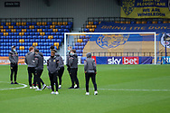 Milton Keynes Dons players walking out onto the pitch of Plough Lane for the first time during the EFL Sky Bet League 1 match between AFC Wimbledon and Milton Keynes Dons at Plough Lane, London, United Kingdom on 30 January 2021.