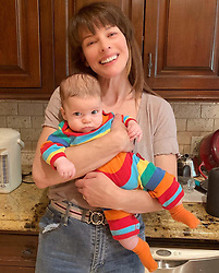 """Milla Jovovich releases a photo on Instagram with the following caption: """"What can I say? I\u2019m just not that into babies.\ud83d\ude0b My dear friend @sokothecat came over yesterday with her delicious little 4 month old baby Indigo and I pretty much didn\u2019t put that little one down for the entire visit! Gonna have to start working on gettin me another one of these little nuggets this year!\ud83e\udd73 #babyenvy #ladiary"""". Photo Credit: Instagram *** No USA Distribution *** For Editorial Use Only *** Not to be Published in Books or Photo Books ***  Please note: Fees charged by the agency are for the agency's services only, and do not, nor are they intended to, convey to the user any ownership of Copyright or License in the material. The agency does not claim any ownership including but not limited to Copyright or License in the attached material. By publishing this material you expressly agree to indemnify and to hold the agency and its directors, shareholders and employees harmless from any loss, claims, damages, demands, expenses (including legal fees), or any causes of action or allegation against the agency arising out of or connected in any way with publication of the material."""