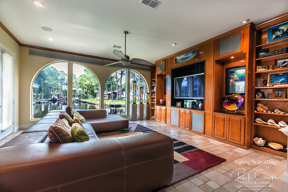 Family/Entertainment Room With Build-In Shelving and Arched Wiundows