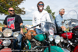 Richard Kaylor, Panhead Fred and Kerry Patchett lined up for the panorama portrait in Aune Osborne Park in Sault Sainte Marie, the site of the official start of the Cross Country Chase motorcycle endurance run from Sault Sainte Marie, MI to Key West, FL. (for vintage bikes from 1930-1948). Thursday, September 5, 2019. Photography ©2019 Michael Lichter.