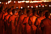 Buddhist monks gather together for Makha Bucha Day at the Wat Phra Dhammakaya, a Buddhist temple in Khlong Luang District, Pathum Thani Province north of Bangkok, Thailand. It is the centre of the Dhammakaya Movement, a Buddhist sect founded in the 1970s and led by Phra Dhammachayo.