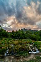 The setting sun illuminates the sky over Cascade Springs in Utah's Wasatch Mountains on a warm Summer evening.