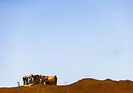 Iron ore and a loader in the Pilbara, Western Australia.