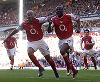 Fotball<br /> England 2004/2005<br /> Foto: SBI/Digitalsport<br /> NORWAY ONLY<br /> <br /> Tottenham Hotspur v Arsenal<br /> 13/11/2004<br /> <br /> Arsenal's Lauren and Thierry Henry celebrate their sides third goal