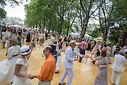 The dance floor on the lawn of Governors Island was crowded with dancers of all ages.