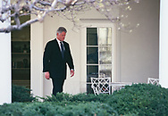 President Clinton walking on the Rose Garden colonnade during th months of the Clinton impeachment drama.<br />Photo by Dennis Brack