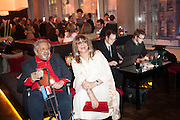 Sir V.S. Naipaul; Lady Nadira Naipaul  and technicians editing photos of the party, Liberatum Cultural Honour  for John Hurt, CBE in association with artist Svetlana K-Lié.  Spice Market, W London - Leicester Square